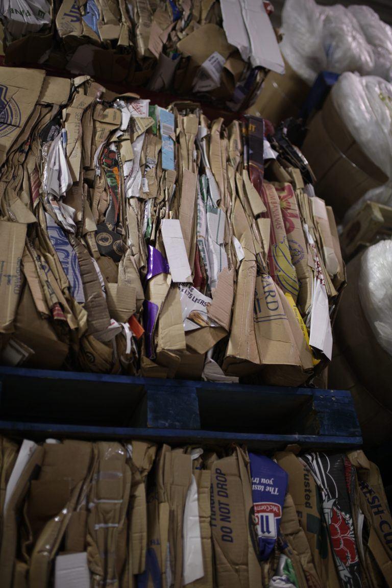 woods supermarket sustainability cardboard bale